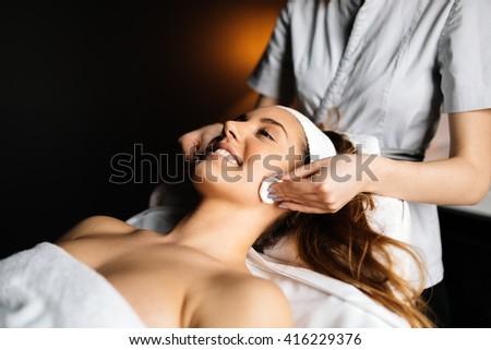 Beautiful woman enjoying massage and rejuvenating - stock photo