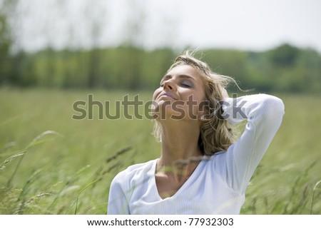 Beautiful woman enjoying sun and fresh air - stock photo