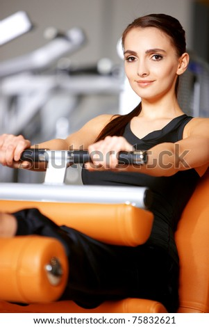 Beautiful woman exercising at the fitness gym - stock photo