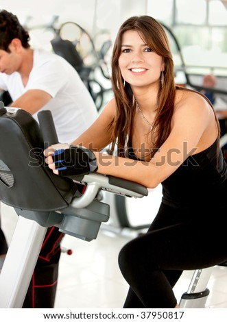 Beautiful woman exercising at the gym and smiling
