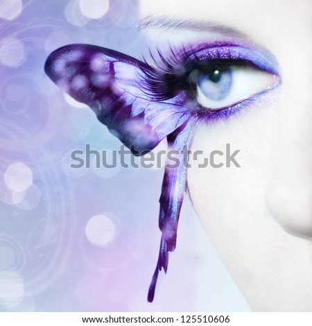 beautiful woman eye close up with butterfly - stock photo