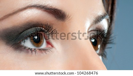 Beautiful woman eyes close-up with make up