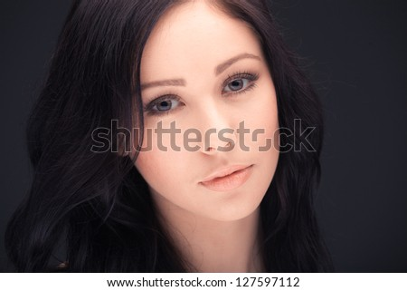 beautiful woman face and shoulders over dark background