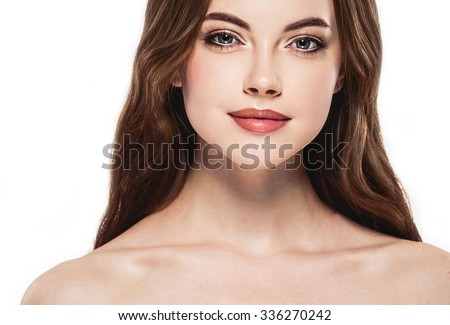 Beautiful woman face close up portrait young studio on white