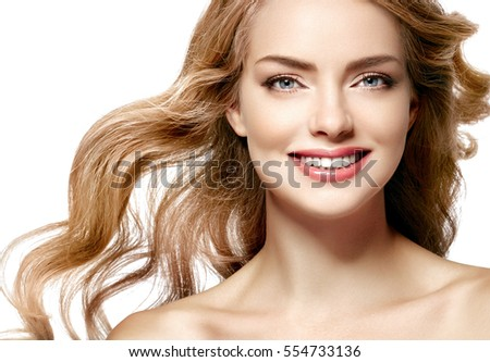 Beautiful woman face close up portrait young studio on white with curly long blonde amazing hair beautiful smile