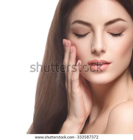 Beautiful woman face close up studio on white  - stock photo