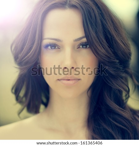Beautiful woman face closeup - stock photo