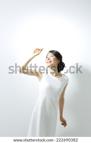 Beautiful woman face isolated on white background, concept for skin care and sun block UV care, asian beauty - stock photo