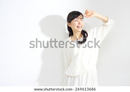 Beautiful woman face isolated on white background, concept for skin care and sun block UV care, asian beauty