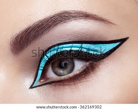 Beautiful woman face. Perfect makeup. Beauty fashion. Eyelashes. Cosmetic Eyeshadow. Make-up detail. Eyeliner - stock photo
