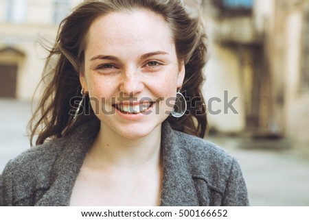 Beautiful woman face portrait freckles street city fashion nature