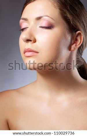 beautiful woman face portrait with closeup eyes over blue - stock photo