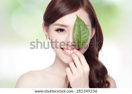 beautiful woman face portrait with green leaf , concept for skin care or organic cosmetics , asian beauty - stock photo
