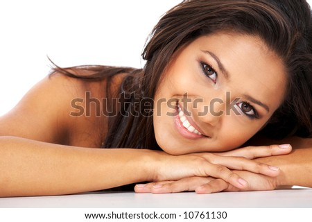 beautiful woman face smiling and leaning on her hands - stock photo
