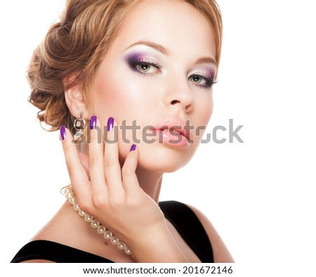 Beautiful woman face with bright makeup and manicure - stock photo