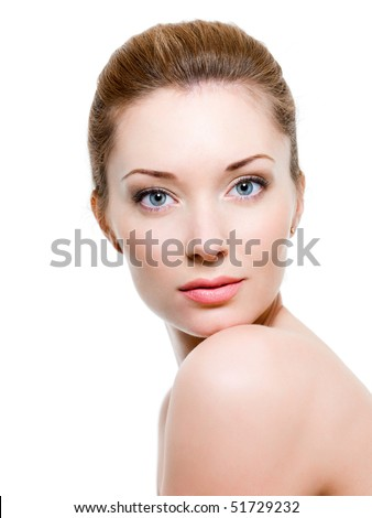 Beautiful woman face with clean skin - isolated on white - stock photo