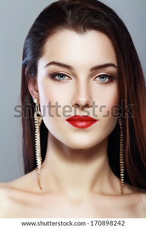 beautiful woman face with perfect make up and red lips anfas - stock photo