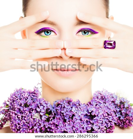 Beautiful Woman Fashion Model. Bright Colorful Makeup and Flowers - stock photo