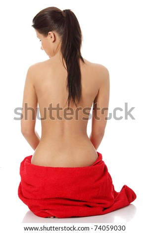 Beautiful woman from behind before spa treatment. Isolated