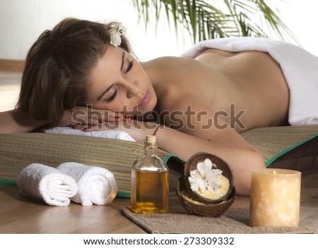 Beautiful Woman Getting Spa Massage in Spa Salon. - stock photo