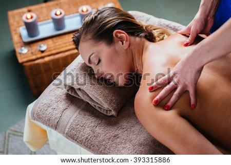 Beautiful woman getting thai massage in exotic spa