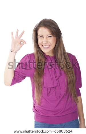 Beautiful woman giving ok sign  with a big smile - stock photo