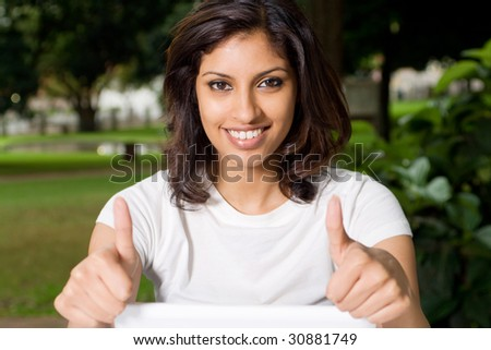 beautiful woman giving thumbs up - stock photo