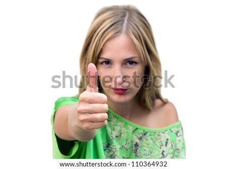 Beautiful woman giving thumbs up for approval - stock photo