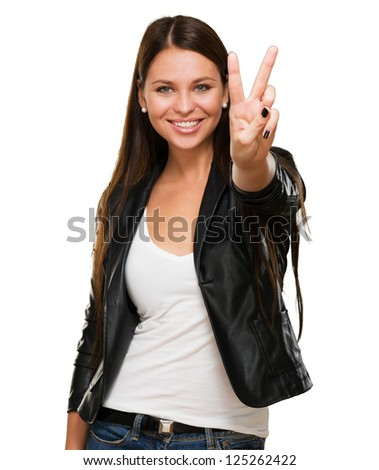 Beautiful Woman Giving Victory Sign Over A White Background - stock photo