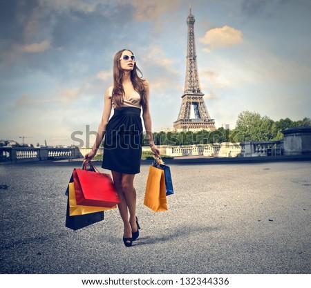 beautiful woman goes shopping in Paris - stock photo