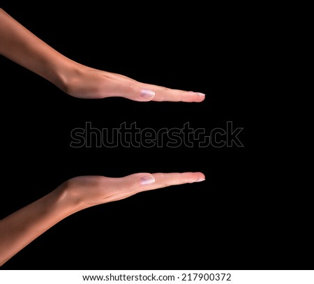 Beautiful woman hand holding isolated on black background