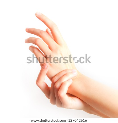 Beautiful woman hands applying cream - stock photo