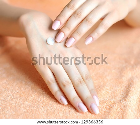 Beautiful woman hands with cream. Skincare concept
