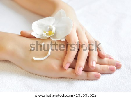 Beautiful woman hands with cream. Skincare concept - stock photo