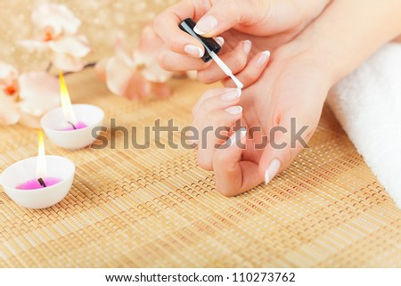 Beautiful woman hands with french manicure - stock photo