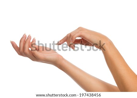 Beautiful woman hands with french manicure nails isolated on a white background - stock photo