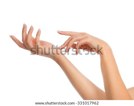 Beautiful woman hands with french manicure nails isolated on a white background