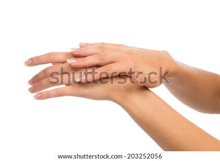 Beautiful woman hands with french manicure nails isolated on a white background Skin care concept
