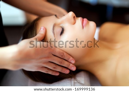 Beautiful woman having a facial massage  - stock photo