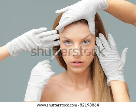 beautiful woman having an injection in wrinkles - stock photo