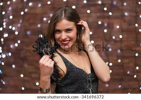 Beautiful woman having fun at the party - stock photo