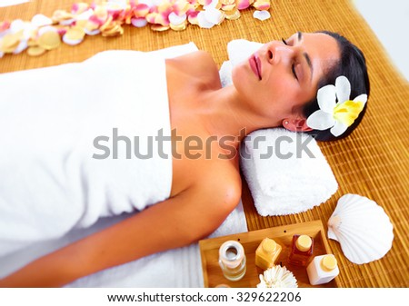 Beautiful woman having massage. Relaxation and health background. - stock photo