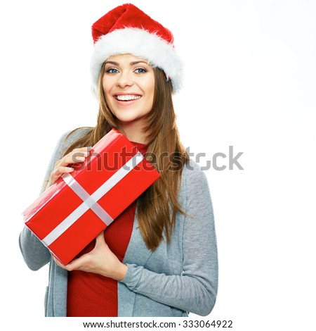 Beautiful woman hold gift. Santa hat. Christmas girl portrait. White background.