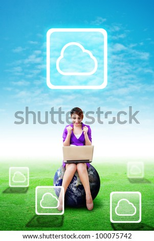 Beautiful woman hold notebook computer and present the Cloud icon on the blue sky and grass field : Elements of this image furnished by NASA - stock photo