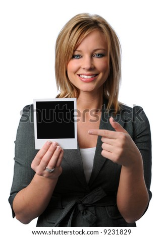 Beautiful woman holding a blank  instant photo isolated over a white background
