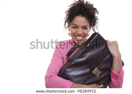 Beautiful woman holding a briefcase - stock photo