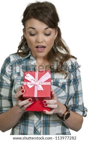 Beautiful woman holding a Christmas gift present - stock photo