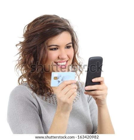 Beautiful woman holding a credit card buying on the smart phone isolated on a white background            - stock photo