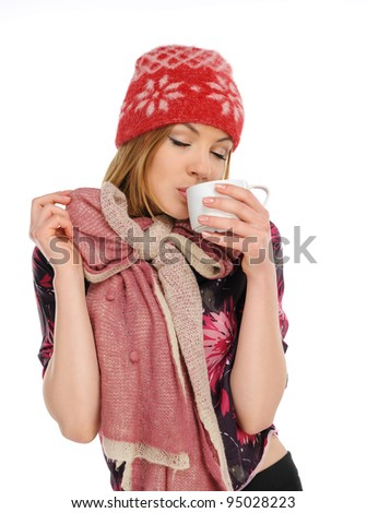 Beautiful woman holding a cup of coffee, isolated on a white background - stock photo