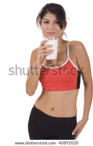 Beautiful woman holding a glass of milk on white. - stock photo